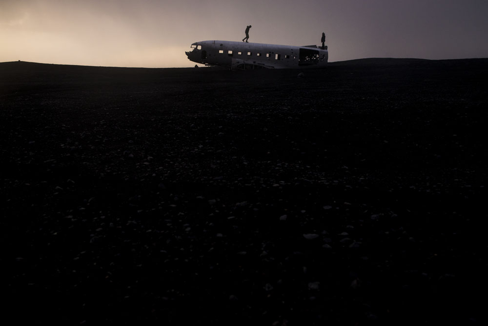 Climbing on top of abandoned US Navy plane on an Iceland road trip